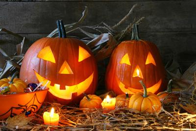 Scarved jack-o-lanterns lit for halloween